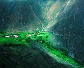 Sinong village situated on narrow strip of cultivated field beside Lantsang River, DiQing Tibetan Autonomous Prefecture, Yunnan Province, China