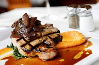 Grilled Pork Porterhouse with Ginger Garnet Yams and Braised Greens