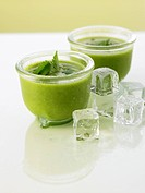 Two glasses of cold lettuce & cucumber soup with coriander