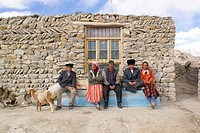 A group of Uyghur people sitting in front of stone block house, Kashgar Prefecture, Xinjiang Uyghur Autonomous Region, China