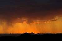 Sunset and rain clouds forming over the Damaraland and Kaokoveld, Namibia, Africa