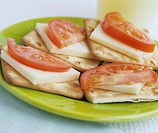 Cheese and tomato on crackers
