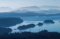 Fulford Harbour and the receding mountain ranges of the Gulf Islands and Vancouver Island are seen from the top of Mount Maxwell on Salt Spring Island...