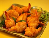 Crispy Fried Shrimp on a dish with Kiwi
