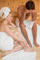 Man and woman sitting in a sauna