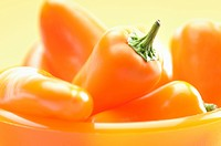 Orange peppers in a bowl close_up