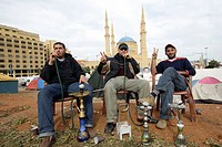 A pause for relaxation with nargileh in the central district with background the Mohammed al Amin mosque. Lebanon Beirut