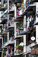 Colourful laundry hanging from the balconies of a modern apartment block, Sandakan, Sabah, Borneo, Malaysia, Southeast Asia