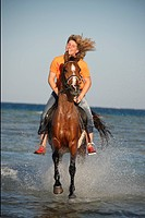 rider on Arabian horse _ riding through water