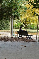 France, Paris, man sitting on park bench