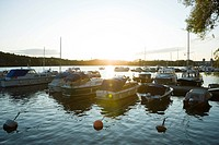 Sweden, Stockholm, marina at sunset