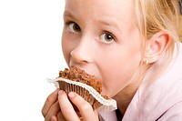 Girl eating a brown muffin