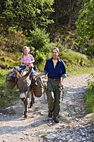 Father and daughter on a donkey hike, Cevennes, Mont Lozere, France, Europe