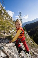 Girl, 5, climbing on Kofel mountain in the Upper Ammergauer Alps, Upper Bavaria, Bavaria, Germany, Europe