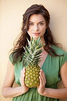 Woman, brunette, pineapple, holding, smiling, portrait,