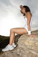 Woman, Sitting, athletic, rocks, exhausting, sidewards, ,