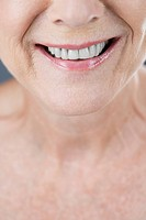 A senior woman smiling, close_up of mouth