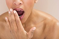 Close_up of a woman yawning