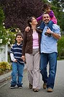 Family walking on residential street