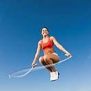 Native American woman jumping rope in mid_air