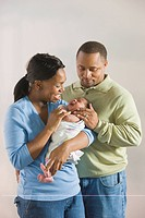 African couple admiring newborn baby