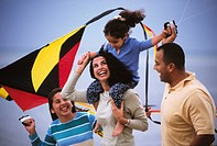 Hispanic family flying kite
