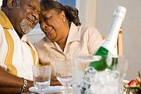 Senior African couple with champagne
