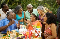African family celebrating birthday outdoors