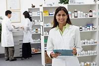 Portrait of Indian female pharmacist in pharmacy