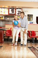 Senior Hispanic couple at bowling alley