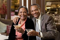 Senior African couple drinking cocktails