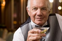 Close up of senior man drinking cocktail