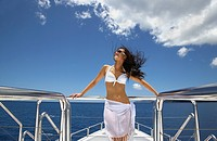 Pacific Islander woman standing on yacht (thumbnail)