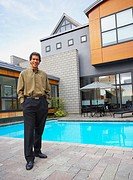 Man standing on patio of house