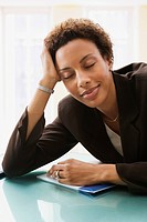 African American businesswoman with eyes closed