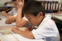 Asian boy doing schoolwork