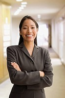 Pacific Islander businesswoman with arms crossed