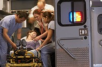 Multi-ethnic medical professionals with patient in ambulance (thumbnail)