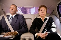 Business people in back seat of car