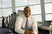 African businessman smiling in conference room