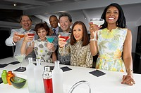 Multi_ethnic group of friends drinking cocktails at party