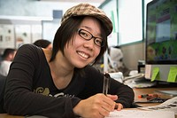 Japanese college student working in classroom