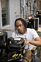 African American refrigeration technician student working in laboratory