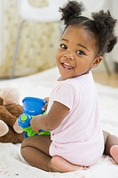 African American girl playing with toy