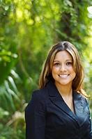 Hispanic businesswoman posing outdoors