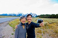 Japanese family taking self_portrait in remote area