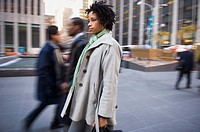 African American woman on urban sidewalk