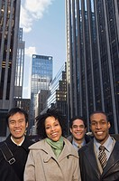 Multi_ethnic businesspeople in urban scene