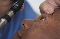 African American man having eye examined