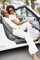 African American couple sitting in convertible